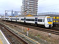 C2C train passing Shadwell (13228298015).jpg