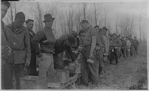 Agassiz National Wildlife Refuge - CCC workers line up for food, 1937. Mud Lake NWR, Minnesota