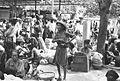 COLLECTIE TROPENMUSEUM Uitgemergelde Chinees op een markt op Bali met voedsel en kleding TMnr 60030926.jpg