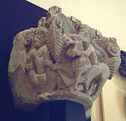Romanesque capital showing Samson and the lion (13th cent.).