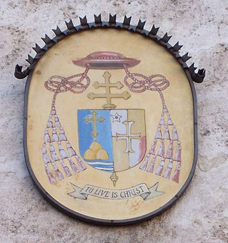 "Bernard Francis Law - Coat of arms of Cardinal Bernard Law, with his motto ""To live is Christ"", in front of Santa Susanna"
