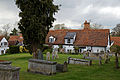 Castle Hedingham, St Nicholas' Church, Essex England, northeast churchyard and 17th-century cottages.jpg
