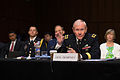Chairman of the Joint Chiefs of Staff Gen. Martin E. Dempsey answers a senator's question during his confirmation hearing before the Senate Armed Services Committee in the U.S. Senate Hart Building in Was 130718-D-KC128-356.jpg