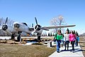 Chaperones and students from St. Joseph's Catholic School in Devils Lake, N.D., take a tour of the military vehicles and aircraft that make up the outdoor museum outside the main gate at Grand Forks Air Force 130426-F-ZZ999-138.jpg