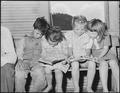 Children in primary grades looking at books. Kentucky Straight Creek Coal Company, Belva Mine, abandoned after... - NARA - 541238.tif
