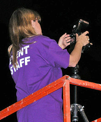 """Chimping - A photographer in the act of """"chimping""""."""