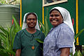 Close up portrait of Christian Care Centre employees Sister Jenny (L) and Sister Ruth (R). (10686975974).jpg
