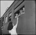 Closing of the Jerome Relocation Center, Denson, Arkansas. Fairwell hand clasps as the train bearin . . . - NARA - 539762.tif