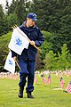 Coast Guard Auxiliary Division 7, place the Coast Guard service flags on the grave sites of Coast Guard members (8822445992).jpg