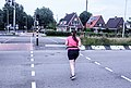 Crossing the road running woman Spijkenisse.jpg