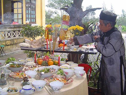 An old man in traditional dress on the occasion of New Year offering Cung tat nien.jpg