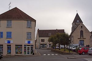 Plaisir, Yvelines - The church and shops in Plaisir