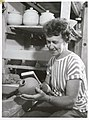 Dame Doreen Blumhardt - a noted New Zealand potter - shaping a pot she has just made.jpg