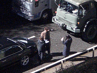 Planet of the Dead - Ryan and Tennant reviewing the script before filming in Butetown at the Queen's Gate Tunnel on 28 January 2009.
