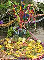 Decorated cross with offerings during the Day of the Cross, El Salvador.jpg