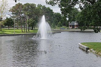 Portland, Maine - Deering Oaks Park with fountain and castle pavilion is located at the point where Interstate 295 meets State Street, Park Avenue, and Deering Avenue