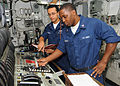 Defense.gov News Photo 100503-N-1082Z-022 - U.S. Navy Petty Officer 2nd Class Alberto Beltran-Lopez provides training on the main propulsion console to Petty Officer 3rd Class Marcus J. Moore.jpg