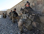 Defense.gov News Photo 101113-A-6521C-059 - U.S. Army soldiers with Charlie Troop 3rd Squadron 89th Cavalry 4th Infantry Brigade Combat Team 10th Mountain Division wait for the order to