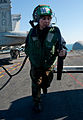 Defense.gov News Photo 111213-N-OY799-135 - U.S. Navy Airman Sandra Leonard carries a power cord to route electrical power to an aircraft on the flight deck of the aircraft carrier USS John.jpg