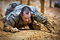 Defense.gov News Photo 120309-A-AO884-167 - Soldiers low crawl while negotiating an obstacle course during their first week of basic combat training at Fort Benning, Ga., on March 9, 2012.jpg