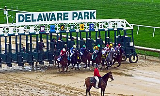 Delaware Park Racetrack - A race begins on a rainy fall day at Delaware Park.