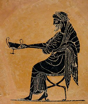 Psiax - Dionysos holding out a kantharos, black-figured plate by Psiax, ca. 520-500 BC, British Museum (B 589).