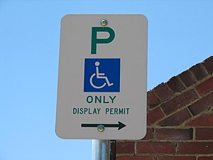 Disabled parking permit - A sign requesting permits be displayed for a disabled parking place in Canberra, Australia.