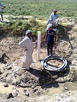 Drilling a hand dug well inside the river 09.jpg