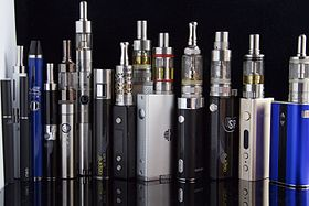 Displaying a variety of e-cigarettes standing next to each other.