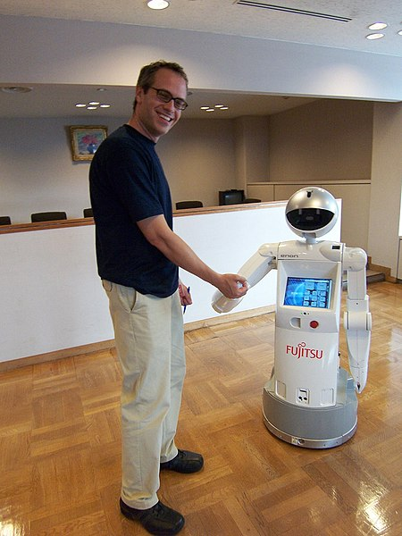 Man meets Robot: From http://commons.wikimedia.org/wiki/File:Enon_robot.jpg