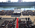 Enterprise (CVN-65) inactivation ceremony, Abraham Lincoln (CVN-72) and Harry S. Truman (CVN-75) in the background.jpg