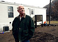 FEMA - 33802 - A resident stands infront of his FEMA supplied mobile home in California.jpg