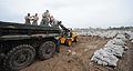 FEMA - 36166 - National Guard stacking sandbags on a truck in Missouri.jpg
