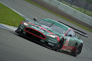 BMS Scuderia Italia - An Aston Martin DBR9 entered by BMS Scuderia Italia.  The team's cars traditionally feature a large stripe painted across the nose or bonnet.