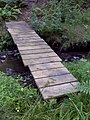 FLT M26 3.9 mi - Bridge over Newton Brook, 16' long, 2x10x36 (or 30) deck boards, 4x6 stringers, steel rebar anchors, 3' to drainage - panoramio.jpg