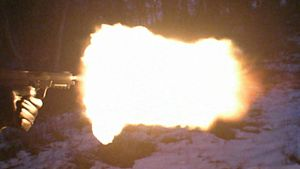 Photo of the Five-seven muzzle flash in dim lighting
