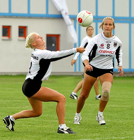 A fistballer sets the ball during international competition Faustball Frauen.jpg