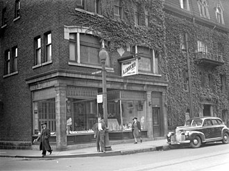 Adélard Joseph Boucher - A.J. Boucher music store at the intersection of Saint Denis Street and the place Christin (now Christin Street) in Montreal. We notice scores and religious statues in the window.