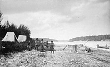 First Nations encampment beside the Albany River in the Northwest Territories, 1886.jpg
