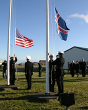 Naval Air Station Keflavik - The flag of Iceland being raised and the flag of the US being lowered as the US hands over the Naval Air Station to the Government of Iceland