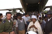 Flickr - Government Press Office (GPO) - IDF OFFICER HELPING ETHIOPIAN IMMIGRANTS.jpg