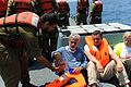 Flickr - Israel Defense Forces - Free Gaza Flotilla Participant Accepts Food From IDF Soldier.jpg