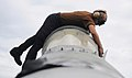 Flickr - Official U.S. Navy Imagery - Airman Chris Pichardo cleans the canopy of an F-A-18C Hornet..jpg