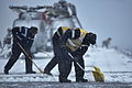 Flight Deck Crews Clear Snow and Ice Onboard HMS Illustrious Near Norway MOD 45153811.jpg