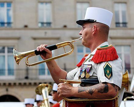 A Caporal-chef, with 3 chevrons of seniority, bugling during the Bastille Day Military Parade.[61] - French Foreign Legion