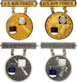 former usaf gold and silver elementary eic badgespng
