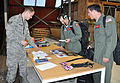 From left, U.S. Air Force Senior Airman Shawn Holloway, a logistics planner with the 517th Expeditionary Airlift Squadron, registers Staff Sgt. Keith Roscoe and Staff Sgt. Justin Davenport Nov. 11, 2013, during 131111-F-FB147-092.jpg