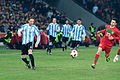 Gabriel Milito (L), Helder Postiga (R) – Portugal vs. Argentina, 9th February 2011 (1).jpg