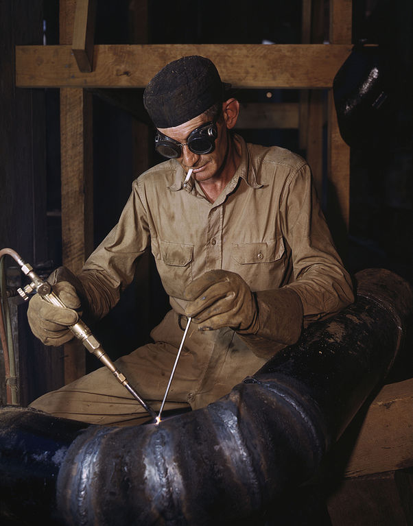 file gas welding a joint in a line of spiral pipe at the. Black Bedroom Furniture Sets. Home Design Ideas
