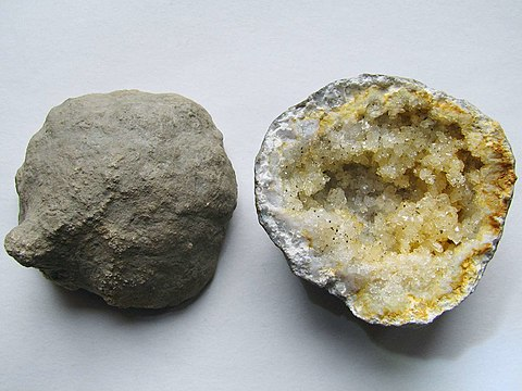 Keokuk geode showing the exterior shell and interior cavity Geode from Keokuk County Iowa.jpg